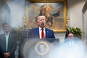 United States President Donald J. Trump speaks to the media after signing two executive orders on transparency in federal guidance and enforcement in the Roosevelt Room of the White House in Washington, DC, USA, 09 October 2019. Trump used the opportunity to speak about his impeachment inquiry, as well as Turkey's move into Syria.<br /> Credit: Jim LoScalzo / Pool via CNP