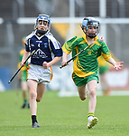 Joe Murnane of Bridgetown in action against Oisin Close of Kilkishen/O Callaghan's Mills during their Schools Division 5 final at Cusack Park. Photograph by John Kelly