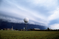 A severe thunderstorm's gust front approaches a WSR-88d Doppler weather radar in Norman Oklahoma. Shelf cloud formations such as these often create wind shears that are extremely hazardous to aircraft.