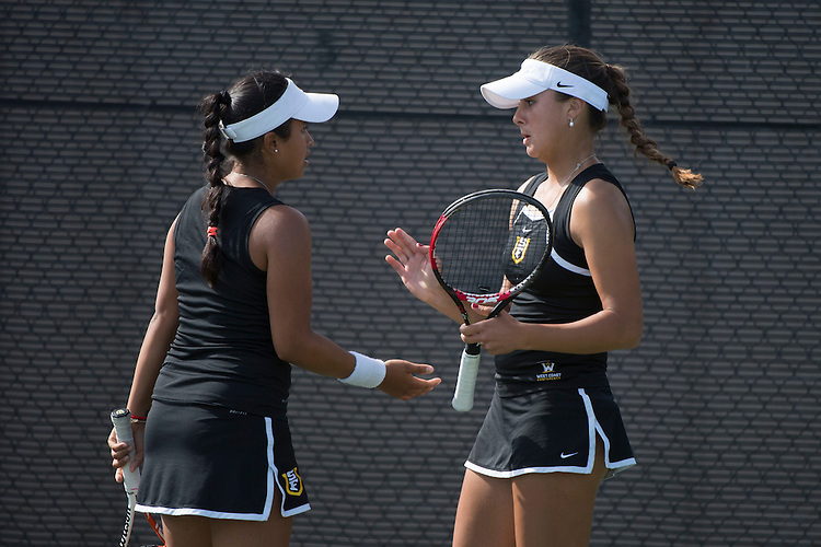 April 23, 2014; San Diego, CA, USA; San Francisco Dons player Andrea Ka (left) and Marina Nikolic (right) during the WCC Tennis Championships at Barnes Tennis Center.