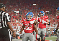 NWA Democrat-Gazette/CHARLIE KAIJO Ole Miss running back Scottie Phillips (22) reacts after a score during the fourth quarter of a football game, Saturday, September 7, 2019 at Vaught-Hemingway Stadium in Oxford, Miss.