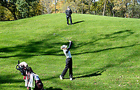 Middleton's Glenna Sanderson hits toward the No. 11 green, as her coach, Becky Halverson, looks on during the Wisconsin WIAA state girls high school golf tournament on Monday, 10/14/19 at University Ridge Golf Course