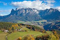Italy, Alto Adige-Trentino (South Tyrol), Renon: view across Soprabolzano into the Dolomites with snowcapped Sciliar (2.563 m) | Italien, Suedtirol, Alto Adige-Trentino, auf dem Ritten: Blick von Oberbozen am Ritten in die Dolomiten mit dem schneebedeckten Schlern (2.563 m)