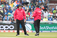 As the rain becomes more persistent umpires Richard Illingworth, and Richard Kettleborough, take the players from the field during India vs New Zealand, ICC World Cup Semi-Final Cricket at Old Trafford on 9th July 2019