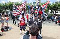 San Francisco, CA - Thursday, June 26, 2014:  USA soccer fans (left to right top row) Stephanie Tam, Anh Tran and Jessica Lee pose for a photo while being held by Mohammad Raza, Christian Setiawan and David Hu after watch the USA vs. Germany first round World Cup match at a public viewing at the Civic Center in San Francisco, CA