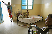 Djibouti. Tadjourah province. Tadjourah. Centre médico hospitalier (CMH). Hospital. Three black muslim men. The one lying on the bed is suffering from HIV Aids and tuberculosis. The Global Fund through the djiboutian Ministry of Health supports the hospital with an Aids grant (financial aid).  © 2006 Didier Ruef