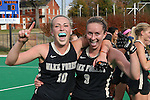 09 November 2014: Wake Forest's Madi Julius (10) and Georgia Holland (9) celebrate after the game. The Wake Forest University Demon Deacons played the Syracuse University Orange at Jack Katz Stadium in Durham, North Carolina in the 2014 Atlantic Coast Conference NCAA Division I Field Hockey Championship Game. Wake Forest won the ACC Championship game 2-0.