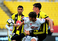 Adelaide's George Blackwood competes with Marco Rossi for the ball during the A-League football match between Wellington Phoenix and Adelaide United FC at Westpac Stadium in Wellington, New Zealand on Sunday, 8 October 2017. Photo: Dave Lintott / lintottphoto.co.nz