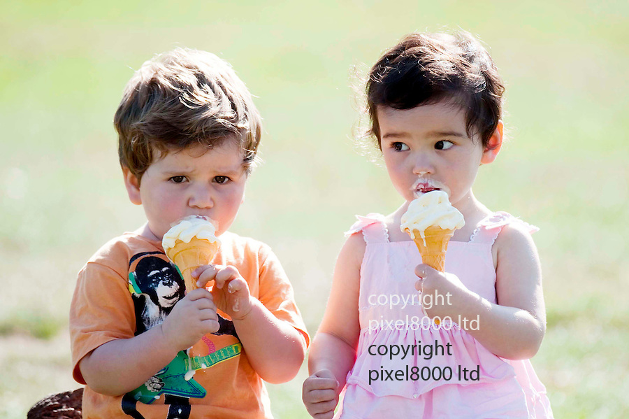 Hot weather 28.9.11.Two kids eat melting ice creams in autumn sunshine -Bushey Park Teddington today..Two year olds, Jacob Genner and Josephine Hobbs ..(parents permission given.).....Pic by Gavin Rodgers/Pixel 8000 Ltd