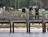 United States Barack Obama, first lady Michelle Obama and daughter Sasha Obama look at fish on their way to take a boat ride in St. Andrews Bay, Sunday, August 15, 2010 In Panama City Beach, Florida. The First Family is visiting the area to help promote tourism and check up on cleanup efforts from the aftermath of the Deepwater Horizon Oil spill. .Credit: Mark Wallheiser - Pool via CNP