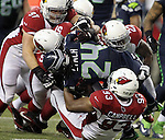Seattle Seahawks running back Marshawn Lynch (24) is stacked up at the line of scrimmage by the Arizona Cardinals at CenturyLink Field in Seattle, Washington on November 15, 2015. The Cardinals beat the Seahawks 39-32.   ©2015. Jim Bryant photo. All Rights Reserved.