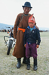 A father and son a the  Naadam festival.    Northern outer Mongolia<br /> <br /> The games are Mongolian wrestling, horse racing, and archery, and are held throughout the country during midsummer. Women have started participating in the archery and girls in the horse-racing games, but not in Mongolian wrestling.