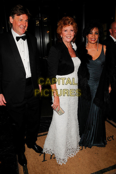 CILLA BLACK & DAME SHIRLEY BASSEY.Attending Bruce Forsythe's 80th Birthday Party, at The Dorchester Hotel, London, England, February 22nd 2008..full length black dress white jacket.CAP/CAN.?Can Nguyen/Capital Pictures