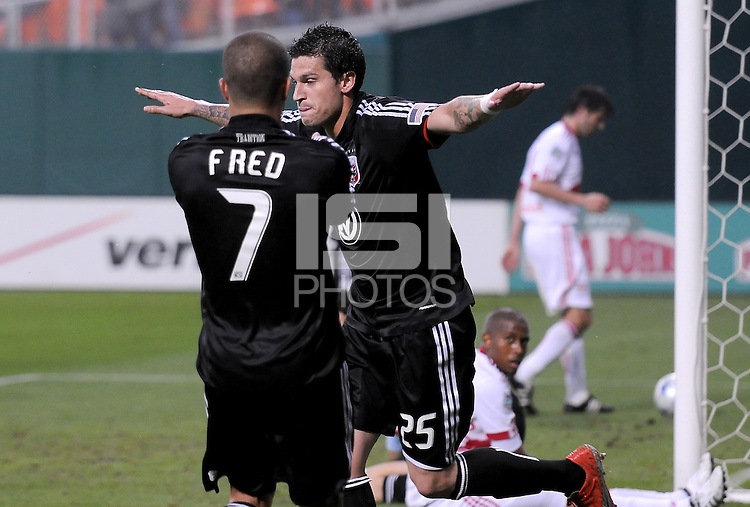 DC United forward Santino Quaranta (25) celebrates his goal with team mate Fred (7) in the 36th minute of the game.   DC United defeated the New York Red Bulls 2-0, at RFK Stadium ,Thursday June 4, 2009.