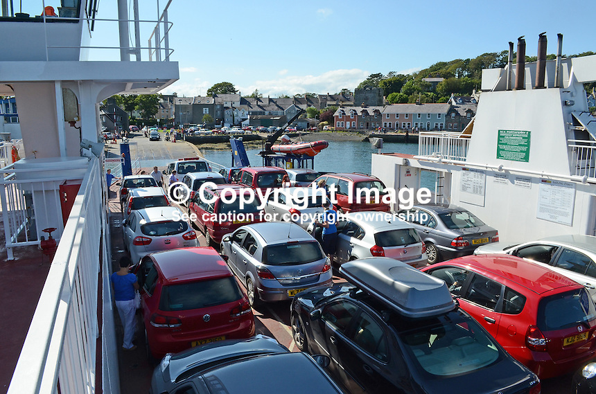 Cars and passengers arrive at Strangford from Portaferry. The Strangford Ferry connects the two towns located at the mouth of Strangford Lough, Co Down, N Ireland, UK, 201208180572..Copyright Image from Victor Patterson, 54 Dorchester Park, Belfast, UK, BT9 6RJ..Tel: +44 28 9066 1296.Mob: +44 7802 353836.Voicemail +44 20 8816 7153.Skype: victorpattersonbelfast.Email: victorpatterson@me.com.Email: victorpatterson@ireland.com (back-up)..IMPORTANT: If you wish to use this image or any other of my images please go to www.victorpatterson.com and click on the Terms & Conditions. Then contact me by email or phone with the reference number(s) of the image(s) concerned.