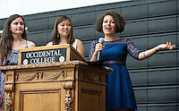 From left, Larissa Saco '14 and Megan Sumida '14 listen as Estrella Lucero '14 talks after receiving the Mortar Board Award for the Promotion of the Status of Women during Senior Brunch and Class Day, May 16, 2014 in Rush Gym. (Photo by Marc Campos, Occidental College Photographer)