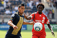 Michael Orozco Fiscal (16)  of the Philadelphia Union plays the ball away from Fuad Ibrahim (7) of Toronto FC.The Philadelphia Union defeated Toronto FC 2-1 on a second half stoppage time goal during a Major League Soccer (MLS) match at PPL Park in Chester, PA, on July 17, 2010.