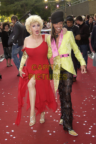 "FAITH BROWN & RICARDO - THE SALON.ITV's ""The Celebrity Awards"".London 26 September 2004.full length, hat, green jacket, coat, trousers, pink trim, red dress, off the shoulder, dancing, gesture, gold gloves.www.capitalpictures.com.sales@capitalpictures.com.©Capital Pictures"