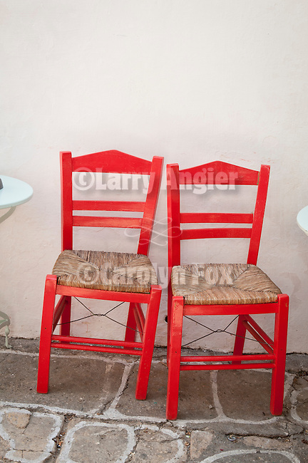 Two red chairs, Folegandros, Cyclades, Greece