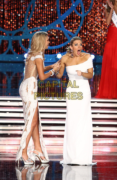 Miss America Mallory Hagan.Miss New York Mallory Hagan is named Miss America 2013 at Planet Hollywood Casino Resort,  Las Vegas, Nevada, USA, 12th January 2013..full length pageant beauty full length on stage white dress one shoulder funny surprised mouth open .CAP/ADM/MJT.© MJT/AdMedia/Capital Pictures.