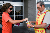 NWA Democrat-Gazette/CHARLIE KAIJO Tanya Martin of Fayetteville (from left) makes a donation to Bob Schmitz during a Tootsie Roll drive, Friday, October 5, 2018 at Walmart in Rogers.<br /><br />The Knights of Columbus is kicking off their annual tootsie rool drive Friday. The fundraiser runs through Oct. 13. They hand out Tootsie Rolls and accept donations, similar to the VFW poppy campaign.