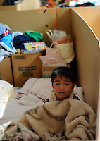 A boy in a Government shelter 16th May 2011,  in Minamisanriku, Myiagi, Japan. The fishing port of Minamisanriku, Miyagi, Japan was devastated by the tsunami where the popultion was reduced from 18,000 to about 8,000 when 10,0000 where washed out to sea.<br /> <br /> Photo by Richard Jones/ Sinopix