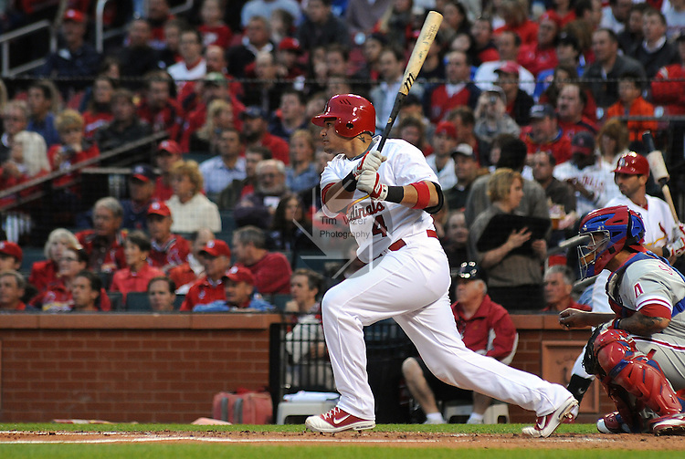 17 May 2011                              St. Louis Cardinals catcher Yadier Molina (4) watches the ball after hitting early in the game. The St. Louis Cardinals defeated the Philadelphia Phillies 2-1 on Tuesday May 17, 2011 in the second game of a two-game series at Busch Stadium in downtown St. Louis.