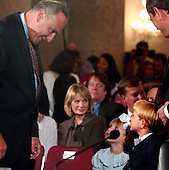 Washington, D.C. - September 12, 2005 -- United States Senator Chuck Schumer (Democrat of New York), left, speaks with Judge John G. Roberts' children, Josie, center, and Jack, right, prior to the United States Senate Committee on the Judiciary hearing on the nomination of John G. Roberts to be Chief Justice of the United States..Credit: Ron Sachs / CNP