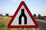 End of dual carriageway red triangular road sign