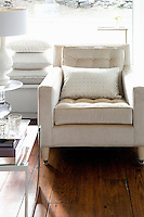 modern white armchair Get A Room is a boutique in Scarsdale New York for interior design.