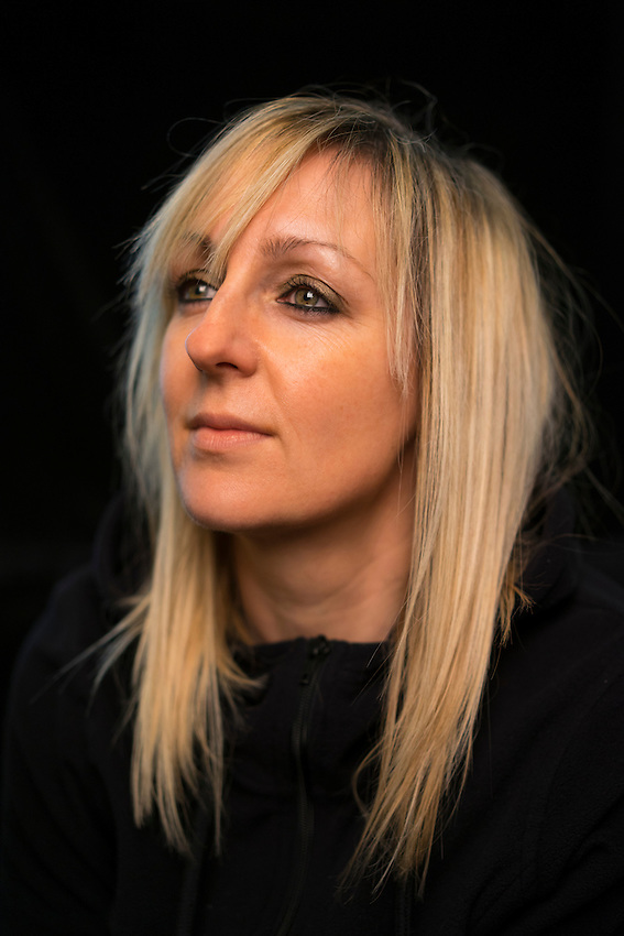 Becky Mitchell, photograped at her home in Bristol. Mitchell was infected with HIV by her partner who did not tell her he was HIV+. Mitchell remains healthy and active despute her diagnosis.