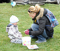 From left, Shawn Holmes, 3, and his mother Rebecca Holmes of Churchville, Pennsylvania open some of the eggs found during an easter egg hunt sponsored by the Feasterville Business Association and the Friends of the Lower Southampton Library Saturday March 19, 2016 at Russell Elliot Park in Feasterville, Pennsylvania. (Photo By William Thomas Cain)