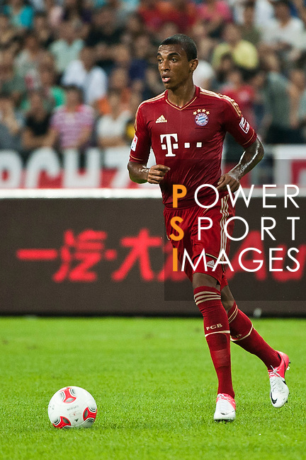 GUANGZHOU, GUANGDONG - JULY 26:  Luiz Gustavo of Bayern Munich in action during a friendly match against VfL Wolfsburg as part of the Audi Football Summit 2012 on July 26, 2012 at the Guangdong Olympic Sports Center in Guangzhou, China. Photo by Victor Fraile / The Power of Sport Images