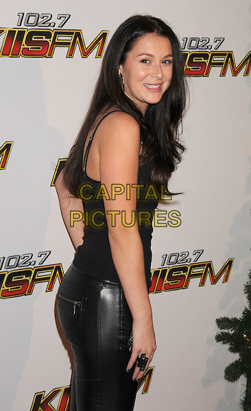 Alexa Vega.The 102.7 KIIS FM's Jingle Ball at the Nokia Theatre L.A. Live in Los Angeles, California, USA..December 3rd, 2011.half length black sleeveless top leather trousers side looking over shoulder .CAP/ROT/TM.©Tony Michaels/Roth Stock/Capital Pictures