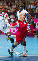 28 JUL 2012 - LONDON, GBR - Heidi Løke (NOR) of Norway shoots during the women's London 2012 Olympic Games Preliminary round handball match against France at The Copper Box in the Olympic Park, in Stratford, London, Great Britain .(PHOTO (C) 2012 NIGEL FARROW)