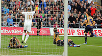 Andre Ayew of Swansea (10) protests to the linesman after his shot was saved by an Arsenal defender during the Barclays Premier League match between Swansea City and Arsenal at the Liberty Stadium, Swansea on October 31st 2015