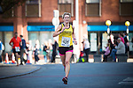 © Joel Goodman - 07973 332324 . 20/09/2015 . Stockport , UK . Women's winner LINDEN HISCOCK (42 from Bramhall )crosses the line at 43 minutes and 7 seconds . The Big Stockport run from St Petersage in Stockport Town Centre . Photo credit : Joel Goodman