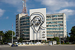 HAVANA - DECEMBER 29: Ministry of Informatics and Communications with the iron portrait of Camilo Cienfuegos on the Plaza de la Revolución in Havana, Cuba.  2013 marks the 60th anniversary of the start of the Cuban Revolution.