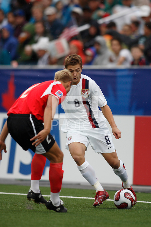 USA midfielder (8) Robbie Rogers is marked by Austria defender (2) Thomas Panny. Austria (AUT) defeated the United States (USA) 2-1 in overtime of a FIFA U-20 World Cup quarter-final match at the National Soccer Stadium at Exhibition Place, Toronto, Ontario, Canada, on July 14, 2007.