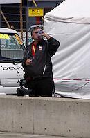 Roger Bedwell enjoys another bottle of vending machine Sake..Twin Ring Motegi, Motegi, Japan, April 2003                             .©F. Peirce Williams 2003..F. Peirce Williams .photography.P.O.Box 455 Eaton, OH 45320.p: 317.358.7326  e: fpwp@mac.com