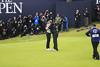 Shane Lowry (IRL) hugs Tommy Fleetwood (ENG) after he wins the Championship by 6 shots at the end of Sunday's Final Round of the 148th Open Championship, Royal Portrush Golf Club, Portrush, County Antrim, Northern Ireland. 21/07/2019.<br /> Picture Eoin Clarke / Golffile.ie<br /> <br /> All photo usage must carry mandatory copyright credit (© Golffile | Eoin Clarke)