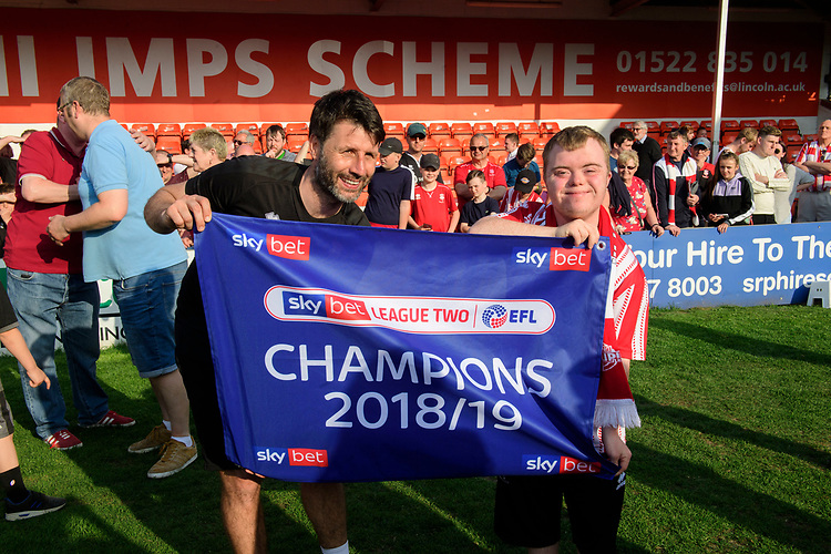 Lincoln City manager Danny Cowley poses for a picture with a fan as they celebrate winning the league<br /> <br /> Photographer Chris Vaughan/CameraSport<br /> <br /> The EFL Sky Bet League Two - Lincoln City v Tranmere Rovers - Monday 22nd April 2019 - Sincil Bank - Lincoln<br /> <br /> World Copyright © 2019 CameraSport. All rights reserved. 43 Linden Ave. Countesthorpe. Leicester. England. LE8 5PG - Tel: +44 (0) 116 277 4147 - admin@camerasport.com - www.camerasport.com