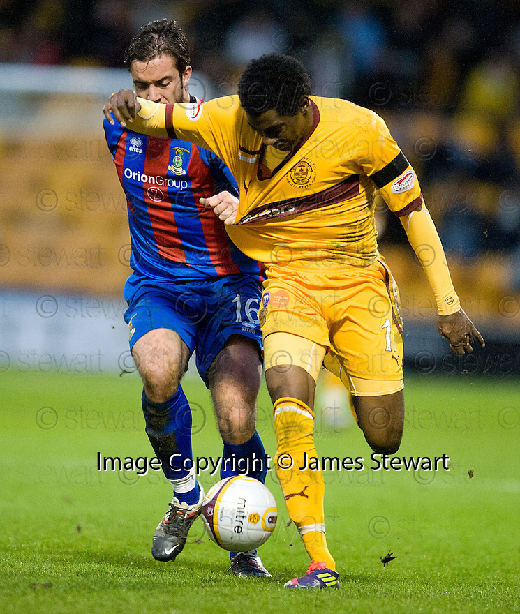 CALEY'S ROMAN GOLABART HOLDS BACK MOTHERWELL'S OMAR DALEY..14/01/2012 sct_jsp011_motherwell_v_ict     .Copyright  Pic : James Stewart.James Stewart Photography 19 Carronlea Drive, Falkirk. FK2 8DN      Vat Reg No. 607 6932 25.Telephone      : +44 (0)1324 570291 .Mobile              : +44 (0)7721 416997.E-mail  :  jim@jspa.co.uk.If you require further information then contact Jim Stewart on any of the numbers above.........