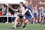 Santa Barbara, CA 02/13/10 - Brandi Cash (BYU # 21) and Deirdra Spillane (UC Davis # 11) in action during the BYU-UC Davis game at the 2010 Santa Barbara Shoutout, UC Davis defeated BYU 9-7.