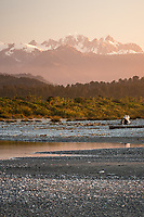 Spectacular sunset views of Southern Alps from beach near Okarito. Mt. Tasman and Aoraki Mt. Cook, Westland Tai Poutini National Park, South Westland, West Coast, UNESCO World Heritage Area, New Zealand, NZ