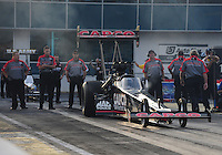 Mar. 9, 2012; Gainesville, FL, USA; NHRA crew members for top fuel dragster driver Steve Torrence during qualifying for the Gatornationals at Auto Plus Raceway at Gainesville. Mandatory Credit: Mark J. Rebilas-