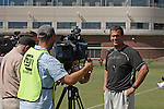 Paul Wulff, new head football coach at Washington State University, conducts interviews with the local media following football practice in Pullman, Washington, on August 10, 2008.
