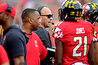 College Park, MD - SEPT 22, 2018: Maryland Terrapins head coach Matt Canada talks to his players during a timeout of game between Maryland and Minnesota at Capital One Field at Maryland Stadium in College Park, MD. The Terrapins defeated the Golden Bears 42-13 to move to 3-1 on the season. (Photo by Phil Peters/Media Images International)