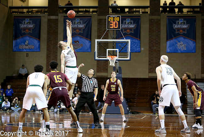 SIOUX FALLS, SD: MARCH 22: Brett Dougherty #32 from Northwest Missouri State jumps for the opening tip against St. Thomas Aquinas during the Men's Division II Basketball Championship Tournament on March 22, 2017 at the Sanford Pentagon in Sioux Falls, SD. (Photo by Dave Eggen/Inertia)