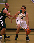 Alumni Dominic Anxo, left, defends against an unidentified Miners player during the alumni game at the Wild West Shootout at Bishop Manogue High School in Reno, Nev., on Wednesday, Dec. 4, 2013. The Miners defeated the alumni 79-62. <br /> Photo by Cathleen Allison